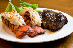 Lobster and Steak. Juicy Grade AAA Angus New York Strip sirloin steak with Lobster Tails stock photos