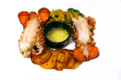 Lobster Tail Dinner. Dish with Drawing butter and broccoli with cheese Royalty Free Stock Image