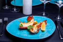 Lobster tail in maple-truffle sauce. With lemon and basil in restaurant stock images