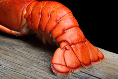 Lobster tail on wood. And black background Stock Photo