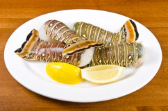 Lobster Tails and Lemon Wedges #1 Stock Photo