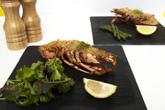 Lobster Thermidor. A meal of half a Lobster Thermidor with Asparagus Spears royalty free stock photo