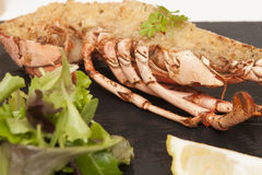 Lobster Thermidor. A meal of half a Lobster Thermidor with Asparagus Spears royalty free stock photography