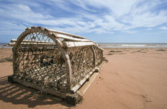 Lobster Trap on the Beach. Lobster trap washed ashore from a storm on the North Coast of Prince Edward Island Royalty Free Stock Photos