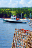 Lobster Trap and Boat in Maine Fishing Port royalty free stock images