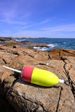 Lobster Trap Buoy on Ocean Shore Rock Royalty Free Stock Photos