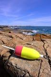 Lobster Trap Buoy on Ocean Shore Rock. Abandoned lobster trap buoy on coastal rock ledge on ocean shore Royalty Free Stock Photos