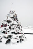 Lobster Trap Christmas Tree near Lighthouse in Snowstorm Stock Images