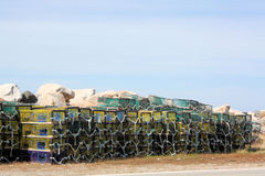 Lobster Traps. Stacked along a rural pier in Nova Scotia, Canada Royalty Free Stock Photo