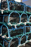 Lobster Traps. A pile of lobster pots on the quay in a small fishing village Royalty Free Stock Photography