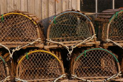 Lobster traps 2. Lobster traps stacked beside a fish shed Stock Photos