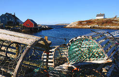 Lobster Traps. A pile of traps on the wharf at Peggy's Cove Nova Scotia. The ocean in the background Stock Photography