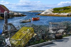 Lobster Traps on a bay with boats and a bay in the background Stock Photos