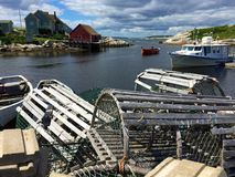 Lobster traps, boats and houses in Peggy's Cove, Canada Royalty Free Stock Photo