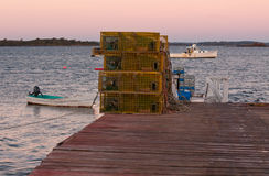 Lobster Traps and Boats at Sunrise Royalty Free Stock Photos