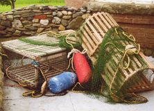 Lobster traps and bouys. With stonewall in background Royalty Free Stock Photography