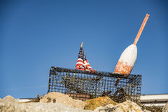 Lobster traps and buoy Stock Images