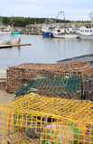 Lobster traps and buoys Stock Images