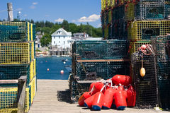 Lobster traps and buoys. Colorful lobster traps and buoys stacked on an old pier in maine Stock Photography