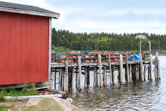 Lobster traps and buoys on wooden pier Stock Photo