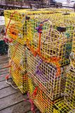 Lobster traps on the dock in Maine. These lobster traps and the colorful lines attached to them were found on a working lobsterman`s dock near Boothbay Harbor royalty free stock photography