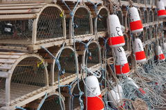 Lobster traps and colourful buoys Stock Photos