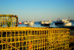 Lobster traps and fishing boats. Lobster traps in the forground, fishing boats in the background in Old Orchard Maine Royalty Free Stock Images