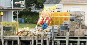 Lobster traps and other equipment on the docks royalty free stock images