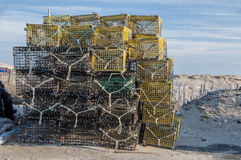 Lobster Traps 7976. Lobster traps piled high at the shore waiting to be loaded onto a fishing vessel Royalty Free Stock Photography