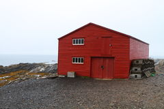 Lobster traps and red shed Stock Photos