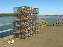 Lobster traps stacked on pier Cape Porpoise Maine Stock Image