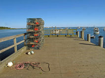 Lobster traps stacked on pier Cape Porpoise Maine and lobster bo Stock Photography