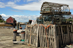 Lobster traps on wharf. Lobster traps stored on wharf of Peggy's Cove fishing village in Nova Scotia Stock Photography