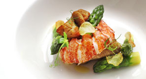 Lobster and veal sweetbread with asparagus. Served on white bowl Stock Photo