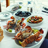 Lobster and vegetables an the table in typical greek taverna, Cr Royalty Free Stock Image