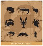 Lobsters and crabs vector silhouettes signs Stock Photo