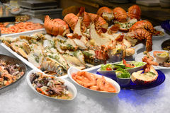 Lobsters on ice; seafood menues in restaurant. Salzburg, Austria royalty free stock images