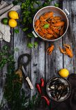 Lobsters and mussels in pans and citrus fruits with herbs on rustic wooden table. Top view of lobsters and mussels in pans and citrus fruits with herbs on rustic Stock Image
