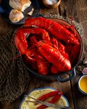 Lobsters in a pot on a rustic wooden table. Freshly cooked lobsters in a pot on a rustic wooden table Stock Images