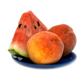 Lobule watermelon and two peach. Royalty Free Stock Photos