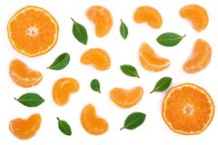 Lobules of mandarin or tangerine with leaves isolated on white background. Flat lay, top view. Fruit composition.  royalty free stock photos