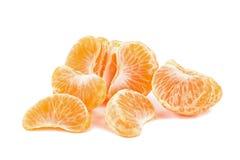 Lobules of mandarins isolated. Lobules of ripe juicy mandarins isolated on white background stock photos