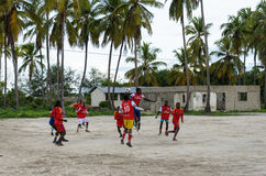 Local african soccer team during training on sand playing field Stock Image