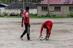 Local african soccer team during training on sand playing field Royalty Free Stock Images