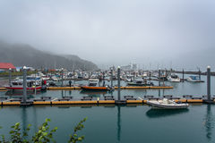 Local Alaska fishing boats on a foggy morning Royalty Free Stock Photography