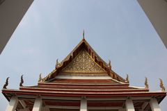 Local Art. Temple Roof And Pediment Decorated With Ornate Thai Art. Vihara in Saket temple.  Roof and the pediment are magnificently  decorated with thai royalty free stock image
