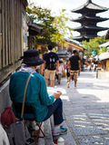 Local artist @ Sannenzaka, Kyoto, Japan. Local artist painting the traditionally preserved streets of the Sannenzaka in Kyoto, Japan. Image taken on 12/09/2015 Stock Photos