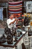 Local artist showing aztec souvenirs made out of obsidian. Obsidian is a naturally formed volcanic glass that was an important part of the material culture of Stock Image