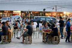 Local Asian Food Restaurant Style in local market. Customer sit in their table and waiting for noodle in an evening market. It's asian style that we can met royalty free stock images