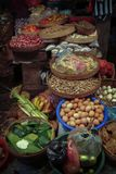 Market Day in Amlapura, Bali, Indonesia. Local Balinese shop almost daily for fresh food and materials for Hindu offerings called `canang`. Refrigeration can be Royalty Free Stock Photo
